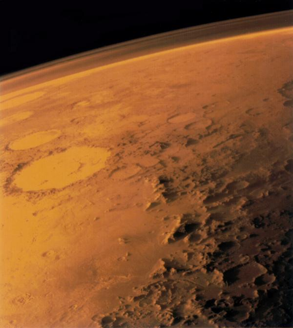 "This <a href=""http://nssdc.gsfc.nasa.gov/nmc/masterCatalog.do?sc=1975-075A"">Viking 1 orbiter</a> image shows the rocky surface and thin atmosphere of Mars."