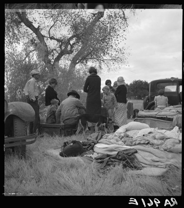 "Dust Bowl refugees camp along a highway near Bakersfield, Calif. (1935) Steinbeck's matriarch, Ma, says, ""All we got is the family unbroke ... I aint scared while we're all here, all that's alive, but I ain't gonna see us bust up."""