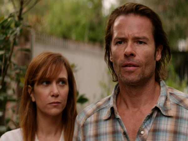 In the film, Johanna (Wiig) falls for her charge's addict father, played by Guy Pearce.