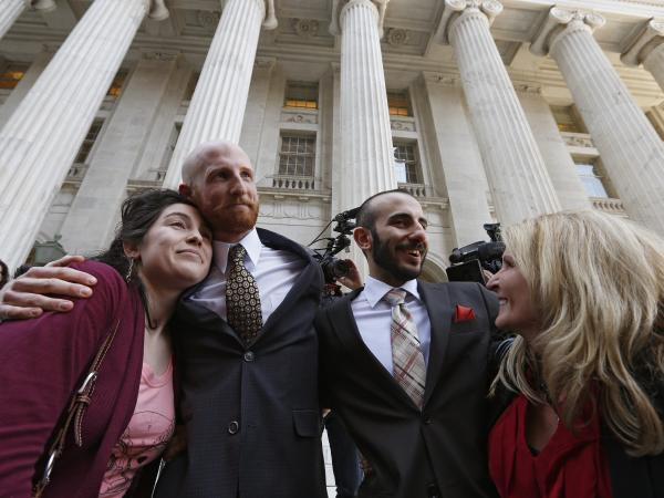 Plaintiff and gay rights activist Derek Kitchen (left) and partner Moudi Sbeity stand with relatives after a hearing at the U.S. Circuit Court of Appeals in Denver on Thursday.