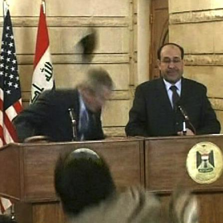 December 2008: President George W. Bush ducks as a shoe flies by during a news conference he was holding in Baghdad with Iraqi Prime Minister Nouri al-Maliki.