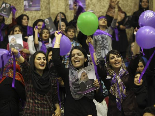 Hasan Rouhani supporters rally for his campaign in the western city of Sanandaj in June 2013. Rouhani pledged to ease social restrictions, but has not taken any major steps since becoming president last summer.