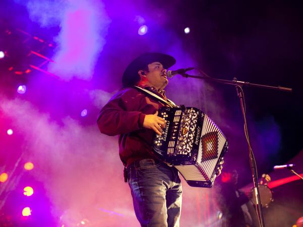 Ricky Munoz, lead singer of Intocalbe, performs in Juarez, Mexico earlier this month. Intocable, a band popular on both sides of the border, is inspired by Mexican music, country hits and rock bands like Def Leppard.