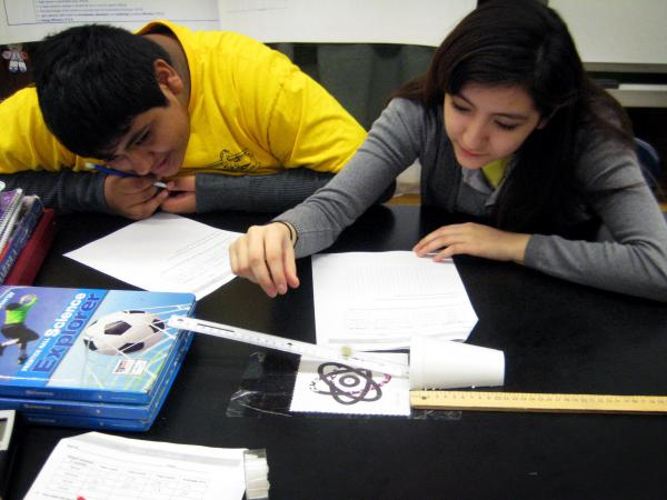 Students at Sawyer Elementary in Chicago try out a mechanical energy lesson that their teacher learned at the museum's training program.