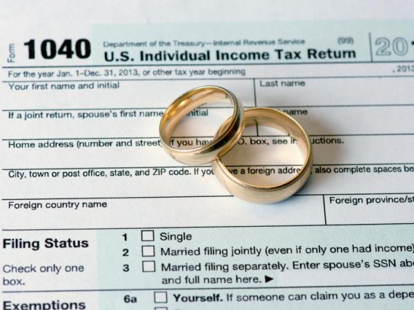 The U.S. tax code, which dates back to the days of <em>Ozzie and Harriet,</em> works against dual-income spouses. In some cases, it's cheaper for one spouse to stay home.