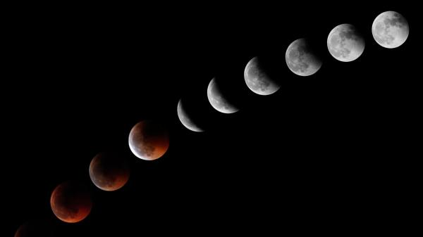 This combination of 10 separate images shows the moon during a total lunar eclipse in 2011 from the Spanish Canary Island of Tenerife.