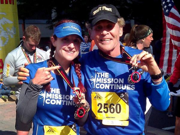 "Demi Clark and her father, Howard Kympton, celebrate after running the Marine Corps Marathon in October. A family proud of its military heritage, they ran in support of an organization called <a href=""https://www.missioncontinues.org/"">The Mission Continues</a> that matches veterans with service projects in the United States. Demi's brother Spencer Kympton helps run the charity."