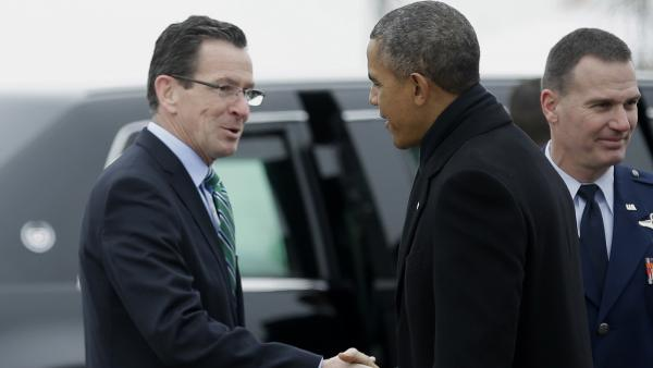 Connecticut Gov. Dannel Malloy greets President Obama March 5 upon his arrival at Bradley Air National Guard Base in East Granby, Conn., before the president traveled to the Hartford area to highlight the importance of raising the minimum wage.