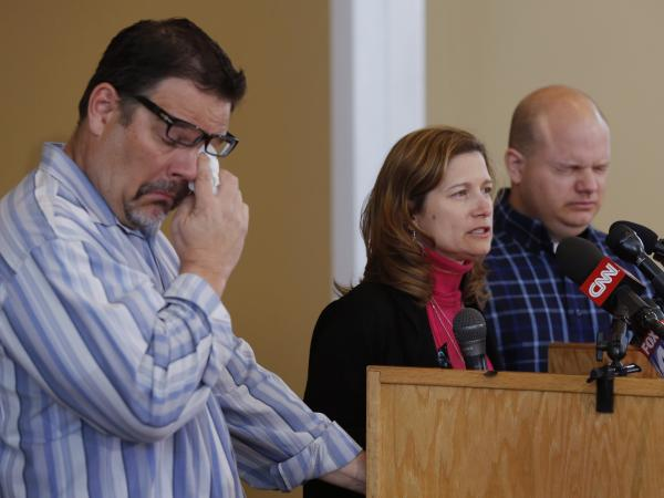 Mindy Corporon speaks during a news conference, flanked by Will Corporon (left) and Tony Corporon, at their church in Leawood, Kan., on Monday. Their father, Dr. William Corporon, and Mindy Corporon's 14-year-old son were killed during Sunday's shooting at the Jewish Community Center in Overland Park, Kan.