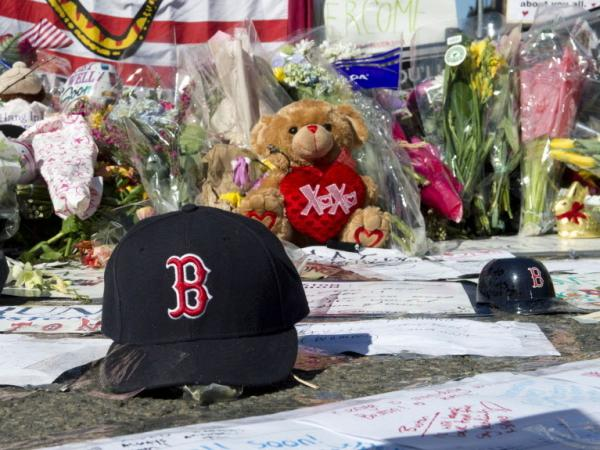 A Boston Red Sox cap left at a makeshift memorial on the Boston Marathon route.