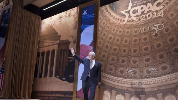Former House Speaker Newt Gingrich waves after addressing the Conservative Political Action Conference annual meeting in National Harbor, Md., on March 8.