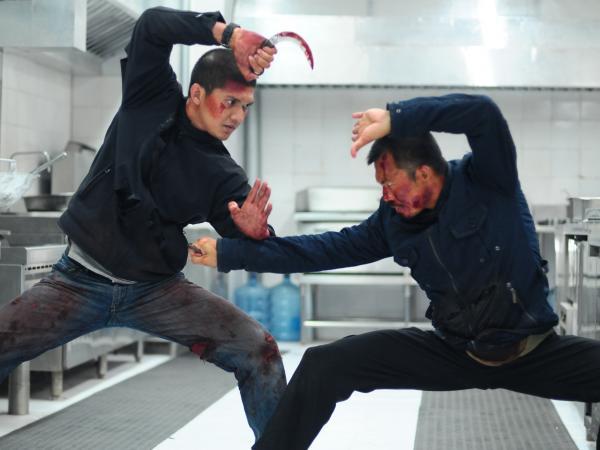Iko Uwais as Rama and Cecep Arif Rahman in <em>The Raid 2</em>.