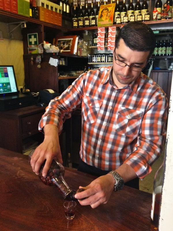 Nuno Goncalves pours out 50-cent glasses of Portuguese <em>ginja</em> — sweet cherry liqueur — in his tiny historic shop in downtown Lisbon. Goncalves recently installed a cash register, but it doesn't print individual receipts. He says no one has ever asked him for one.