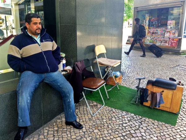 A shoe shiner named Joao says times are so tough that he can't afford to register his business or pay income tax.