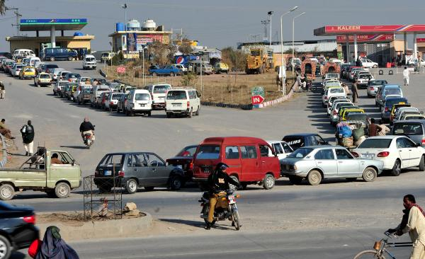 Pakistani motorists wait in line at a refueling station in the outskirts of Islamabad on Jan. 20, 2013. Waits of up to four hours have become a way of life since Pakistan decided to switch to compressed natural gas about a decade ago.