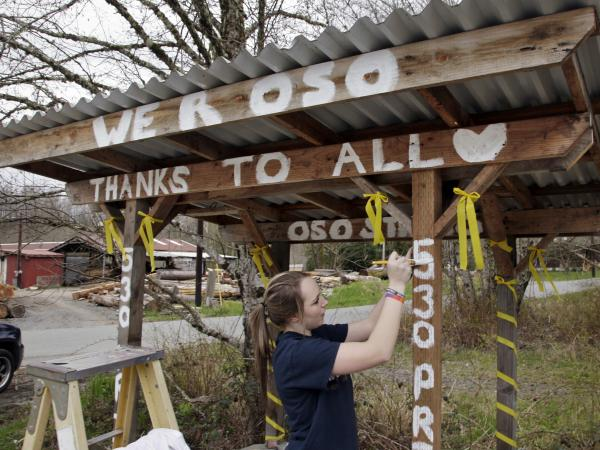 Tayler Drayton, 16, earlier this month painted words of support on a bus stop for those affected by the deadly mudslide at the North Fork of the Stillaguamish River.