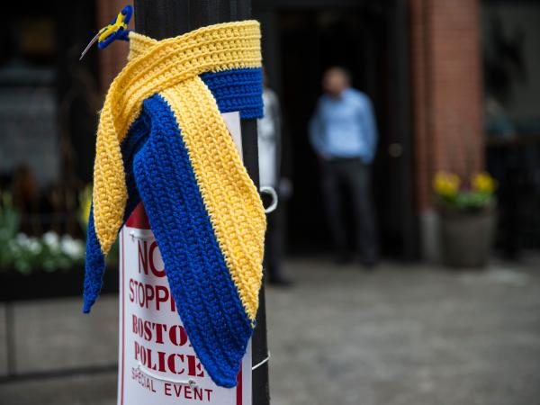 Blue and yellow are the colors for tributes to victims of the Boston Marathon. Street lights on the route of this year's race are among the places they're showing up.