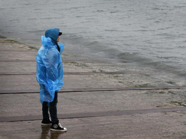 Holding out hope, fearing the worst: A man looks out from the shore in Jindo, South Korea, toward where a passenger ferry sank Wednesday and nearly 300 people are still missing.