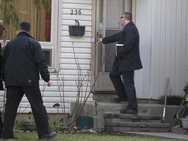 "Royal Canadian Mounted Police investigators canvass the London, Ontario, neighborhood around the home of Stephen Solis-Reyes, who has been charged in connection with exploiting the ""Heartbleed"" bug."