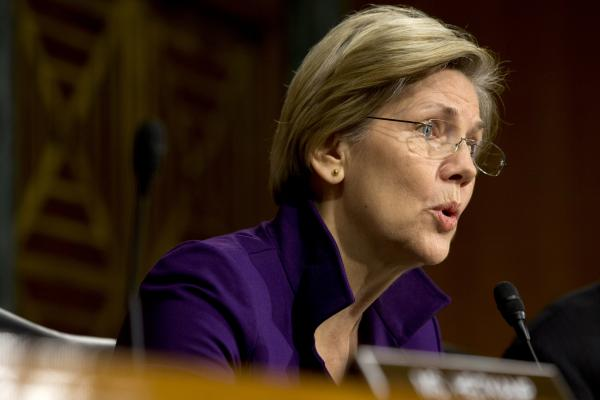 Sen. Elizabeth Warren, D-Mass., at a hearing of the Senate Banking, Housing and Urban Affairs Committee last year. Her book, <em>A Fighting Chance</em>, comes out next week.