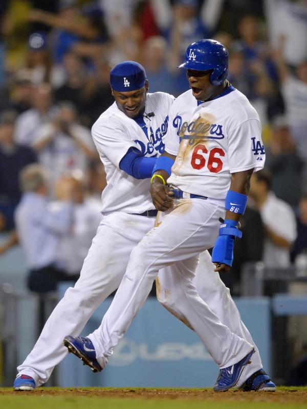 Latino Dodgers players Yasiel Puig and Hanley Ramirez often celebrate with each other.