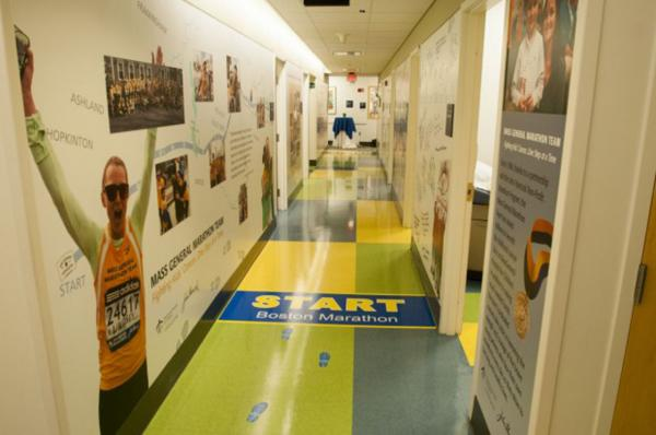 A mural in MGH's pediatric cancer clinic tells the story of the hospital's marathon team, which was founded by Dr. Howard Weinstein, chief of MGH's pediatric hematology-oncology program, in 1998. (Courtesy of MGH)