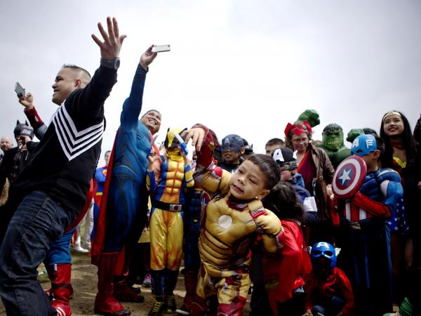People arrive on the National Mall Friday dressed as comic book characters during the kickoff of Awesome Con 2014 in Washington, D.C.