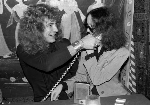 Robinson goofs around with Robert Plant at a New York City restaurant in 1976.