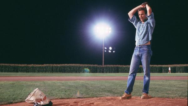 Kevin Costner warms up to pitch in the 1989 film <em>Field Of Dreams</em>.