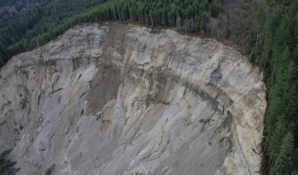 The aftermath of the March 22, 2014 Oso mudslide. The state of Washington has canceled a timber sale near the town so it can assess risks to the public.