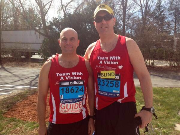 Peter Sagal and Erich Manser are pictured about an hour before the start of the Boston Marathon. (@Peterruns/Twitter)