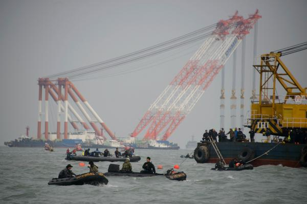 Boats and cranes surround the site of the submerged 'Sewol' ferry off the coast of Jindo on April 21, 2014. (Ed Jones/AFP/Getty Images)