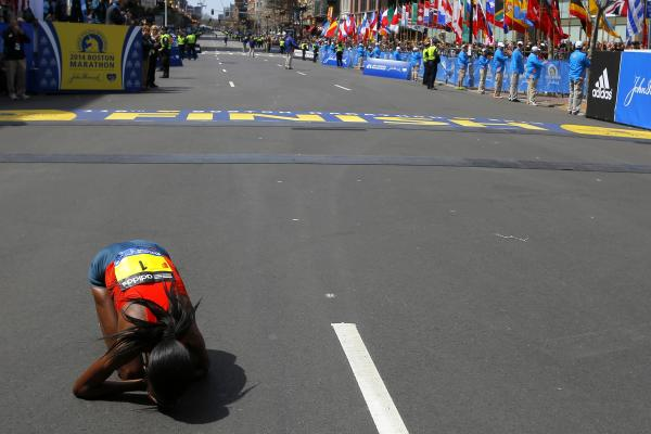 Rita Jeptoo of Kenya reacts after winning the women's division of the marathon. This is the second-largest field in the race's history.