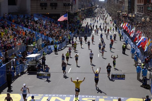 Runners approach the finish line during the 118th running of the Boston Marathon on Monday. A number of the world's top runners were in the field amid heavy security one year after a deadly terrorist bombing.