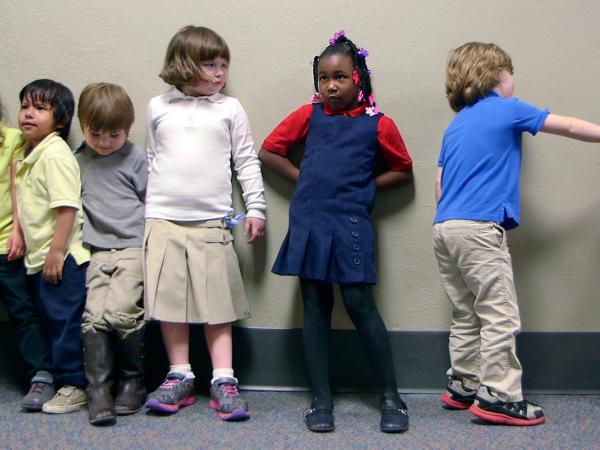 Preschool students from Nikki Jones's class at Porter Early Childhood Development Center in Tulsa line up in the hallway on their way back from outside play.