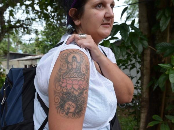 British tourist Naomi Coleman displays the tattoo that has gotten her deported from Sri Lanka.