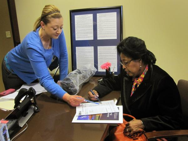 Bridgeit Vaughn (left), of the billing office at Mid State Orthopaedic, meets with Gayle Jackson-Pryce to discuss the costs of Jackson-Pryce's upcoming shoulder surgery.