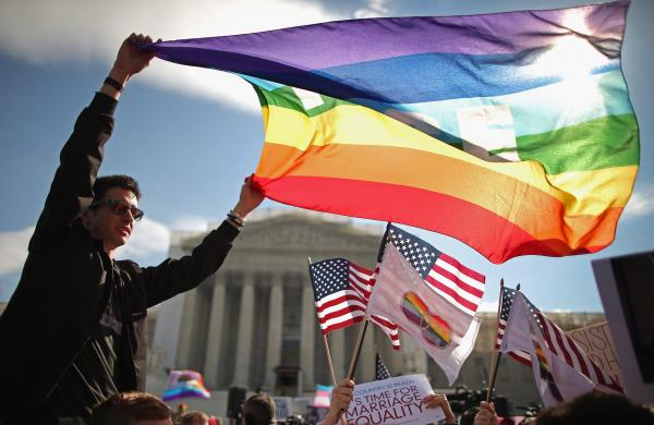 In her new book, <em>Forcing the Spring,</em> investigative reporter Jo Becker goes behind the scenes in the fight for marriage equality. Above, Eric Breese of Rochester, N.Y., joins hundreds of others to rally outside the Supreme Court during oral arguments in a case challenging the Defense of Marriage Act on March 27, 2013.