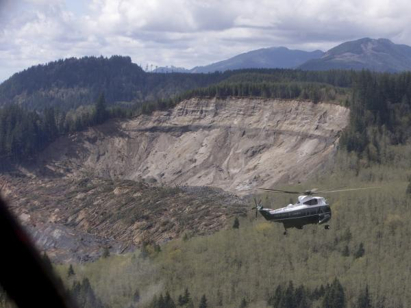 Marine One, carrying President Obama, takes an aerial tour of Oso, Wash., on Tuesday. The president made a brief stop in the area devastated by last month's mudslide.