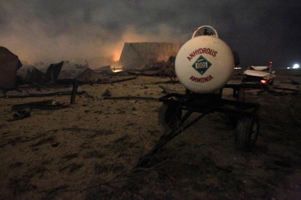 A chemical trailer sits among the remains of the burning fertilizer plant in April 2013.