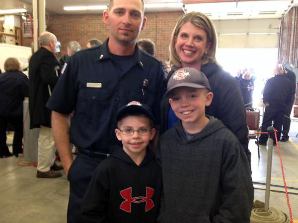 Landon Harper, front right, and his brother Levi the sons of the Oso fire chief, pose with their mom and uncle.