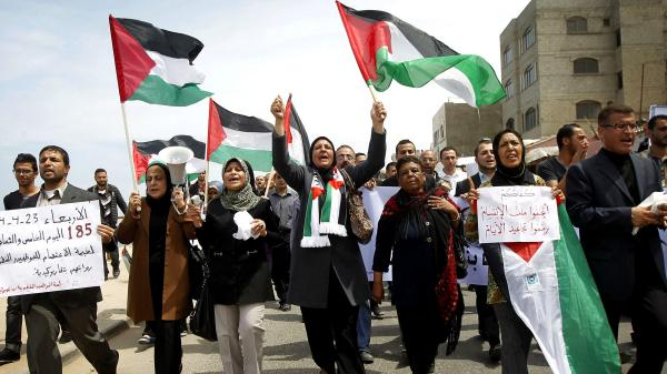 Palestinians march Wednesday in Gaza City in support of an attempt to reconcile the two main factions. Those factions, Hamas and the Palestine Liberation Organization, have been bitterly divided since 2007. They hope to form a unity government within five weeks.