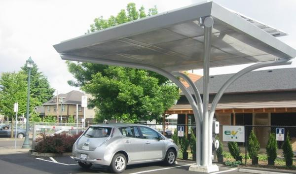 Will putting solar panels on top of electric car charging stations make them more cost-effective?