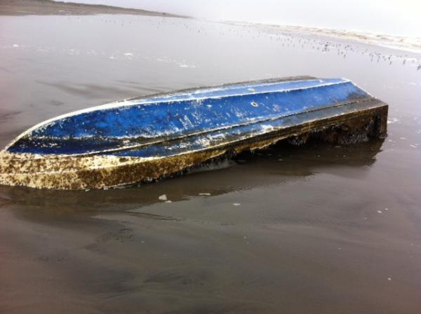 Park rangers are investigating the origin of this skiff found near Long Beach, Wash., on Wednesday morning.