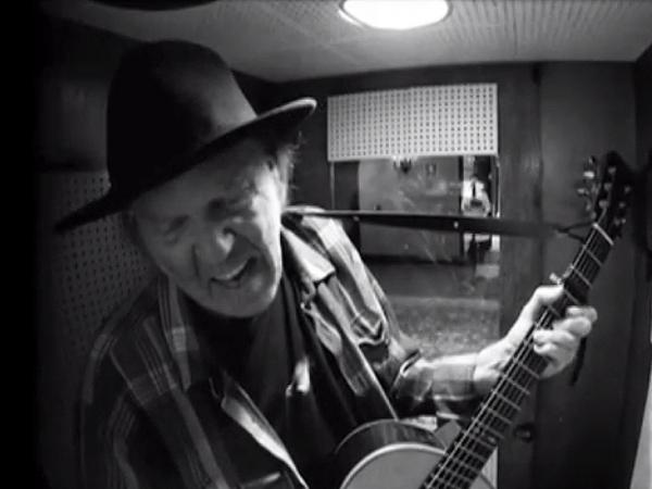 "Neil Young in a recording booth, tracking a cover of Bert Jansch's ""Needle Of Death."""