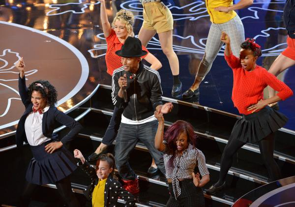 "Pharrell Williams (center) performs ""Happy"" at the 2014 Oscars in Los Angeles."