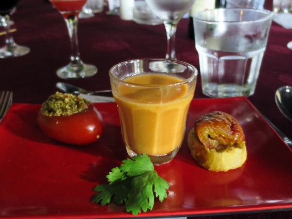 A couscous-stuffed tomato, tomato gazpacho and a piece of bruschetta at a recent Trio Toques event.