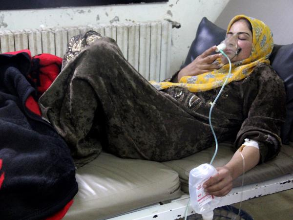 A woman, affected by what activists say was a chlorine gas attack, breathes through an oxygen mask inside a field hospital in Kfar Zeita village in the central province of Hama on April 12. Activists, doctors and political opposition members say there have been at least seven gas attacks in the past six weeks.
