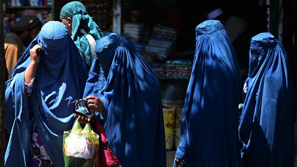 Afghan women shop in Kabul Saturday. Women cast more than a third of the ballots — 36 percent — in Afghanistan's presidential election, officials said. The race will likely head to a runoff next month.