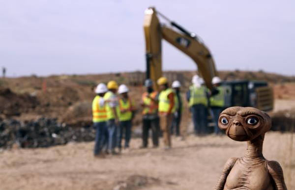 An E.T. doll was held up at the site of an exploratory dig for old Atari video games Saturday. Workers dug into a landfill in Alamogordo, N.M., that had long been rumored to be the final resting place of millions of copies of the game E.T. The Extra-Terrestrial.